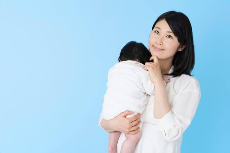 悩む母親と赤ちゃん
